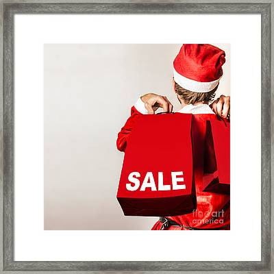 Santa Helper With Gifts At Christmas Shopping Sale Framed Print