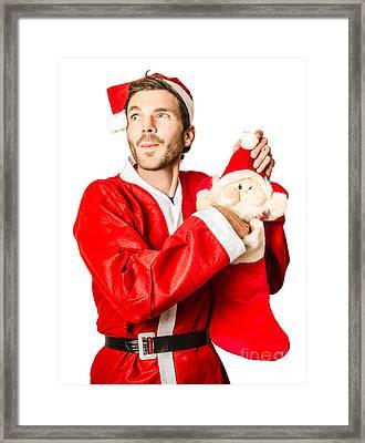 Santa Stocking Up On Christmas Gifts Framed Print