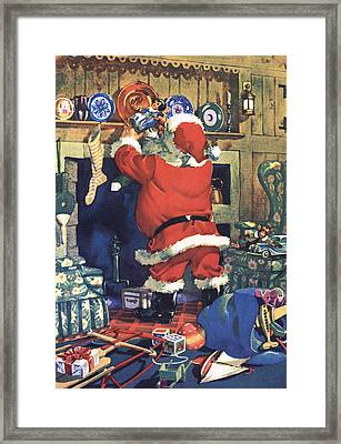 Santa Stuffing Stockings With Toys On Christmas Eve Framed Print by American School