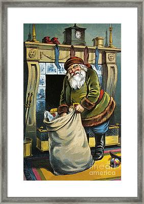 Santa Unpacks His Bag Of Toys On Christmas Eve Framed Print by William Roger Snow