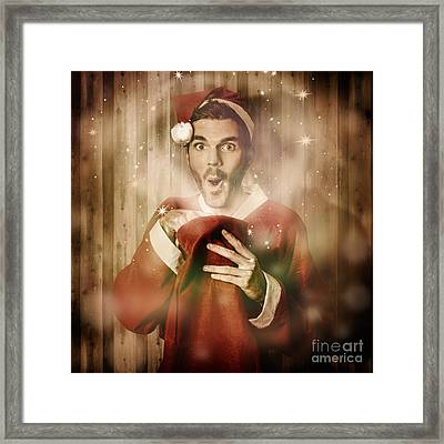 Santa With Surprise Christmas Gift Bag Framed Print by Jorgo Photography - Wall Art Gallery
