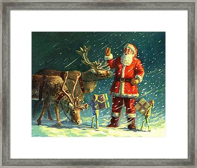 Santas And Elves Framed Print by David Price
