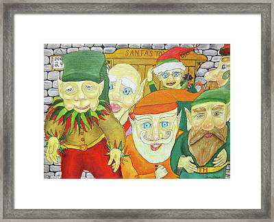 Santas Elves Framed Print by Gordon Wendling