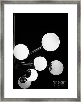 Satellite Moons Framed Print