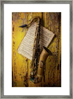 Saxophone Hanging On Old Wall Framed Print