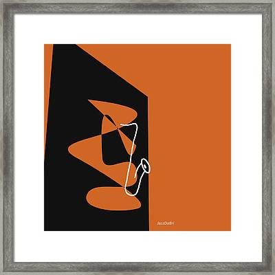 Saxophone In Orange Framed Print