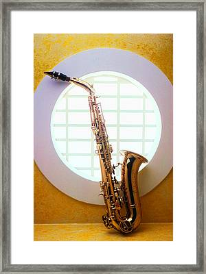 Saxophone In Round Window Framed Print by Garry Gay