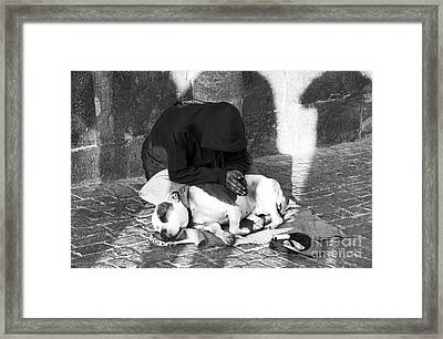 Say A Prayer In Prague Framed Print by John Rizzuto