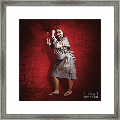 Scary Clown Doctor About To Give Jab With Syringe Framed Print