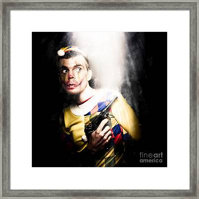 Scary Clown Standing In Shadows With Smoking Gun Framed Print