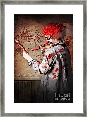 Scary Medical Clown Injecting Horror Into Limb Framed Print by Jorgo Photography - Wall Art Gallery