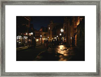Scene From French Village Street At Night At Disney Epcot Framed Print