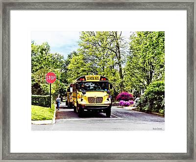 School Buses At Stop Sign In Spring Framed Print by Susan Savad