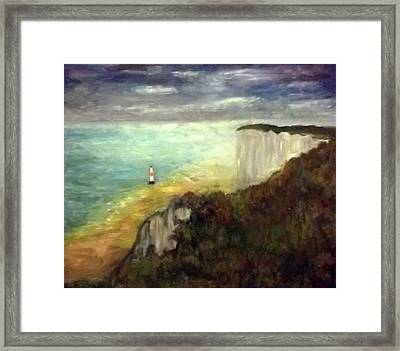 Sea, Cliffs, Beach And Lighthouse Framed Print