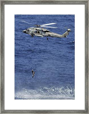 Search And Rescue Swimmers Framed Print