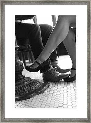 Seated Couple Playing Footsie - F Framed Print by Gillham Studios