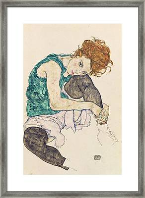 Seated Woman With Bent Knee Framed Print by Egon Schiele