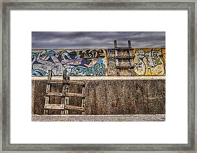 Seawall Framed Print by Ryan Wyckoff