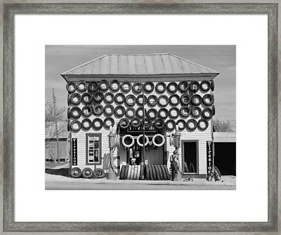 Secondhand Tires Displayed For Sale Framed Print by Everett