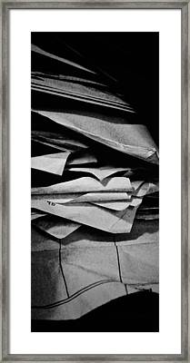 Self Portrait In A Pile Of Paper Framed Print