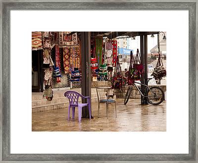 Selling At The Bazaar Framed Print by Rae Tucker