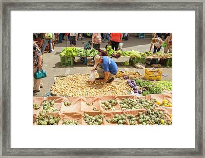 Selling Onions On A Market Framed Print by Patricia Hofmeester
