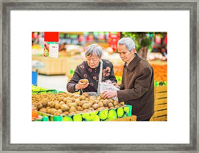 Senior Man And Woman Shopping Fruit Framed Print