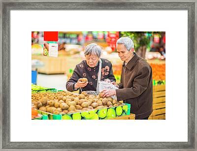 Senior Man And Woman Shopping Fruit Framed Print