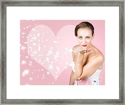 Sensual Woman Blowing Flower Petal Kiss Framed Print