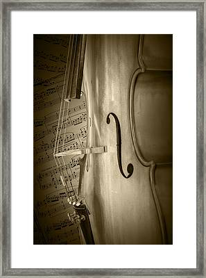 Sepia Toned Photo Of A Cello With Sheet Music Framed Print