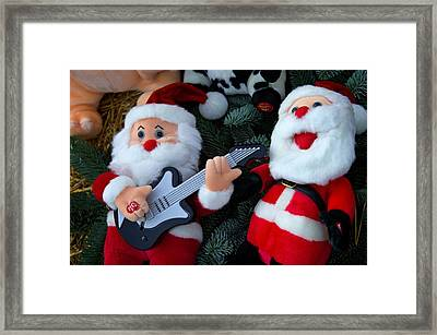 Serenading Santas Practice Carols Framed Print by Keenpress
