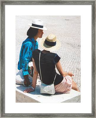 Serious Discussion Framed Print by Andrea Simon