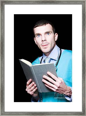 Serious Doctor Holding Medical Research Book Framed Print by Jorgo Photography - Wall Art Gallery