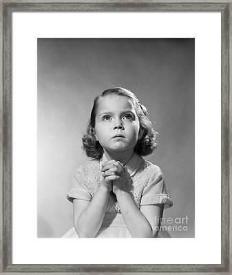 Serious Little Girl Praying, C.1950s Framed Print by Debrocke/ClassicStock