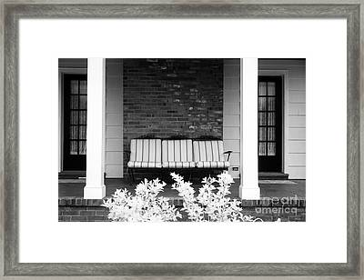 Settee On The Front Porch Framed Print by John Rizzuto
