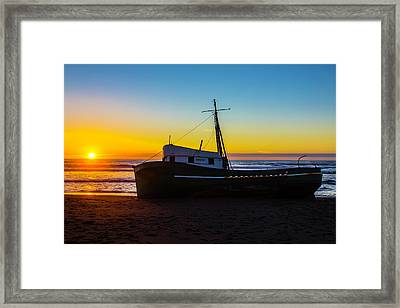 Setting Sun Beached Green Boat Framed Print by Garry Gay