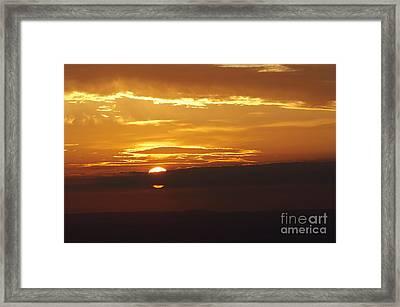 Setting Sun Behind A Cloud Framed Print