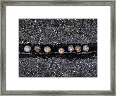 Seven Bottle Caps Framed Print