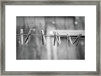 Seven Clothes Pins Framed Print