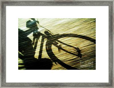 Shadow Of A Person Riding A Bicycle Framed Print by Sami Sarkis