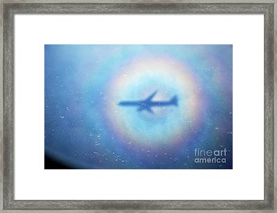 Shadow Of An Aeroplane Surrounded By A Rainbow Halo Framed Print by Sami Sarkis