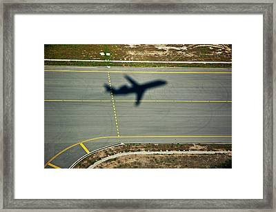 Shadow Of An Airplane Taking Off Framed Print by Sami Sarkis