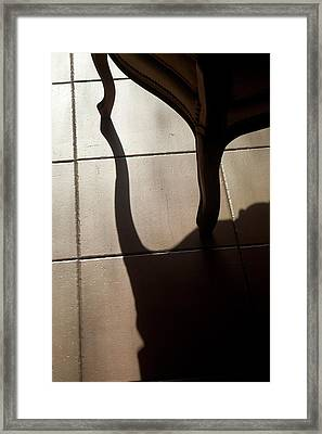 Shadow Of An Armchair On A Tiled Floor Framed Print by Sami Sarkis