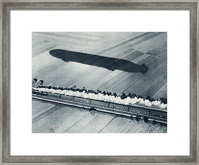 Shadow Of The Fast Zeppelin Air Ship Framed Print by Vintage Design Pics