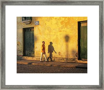 Shadow Walking Framed Print