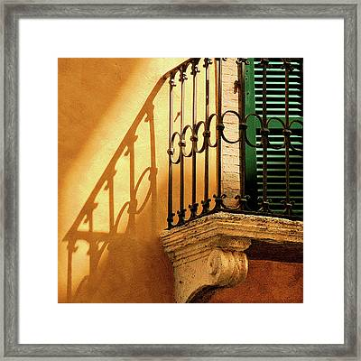 Shadows And Green Shutter Framed Print