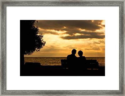 Sharing A Sunset Framed Print by Carl Jackson