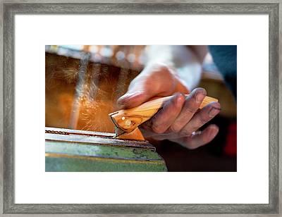 Sharpening The Blade Framed Print