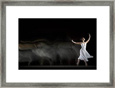 She in Motion Framed Print by Andre Arment
