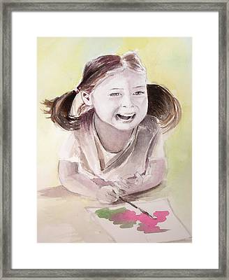She Plays Framed Print